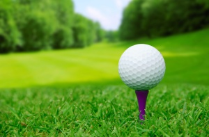 Golf ball on course with beautiful blurry landscape on background